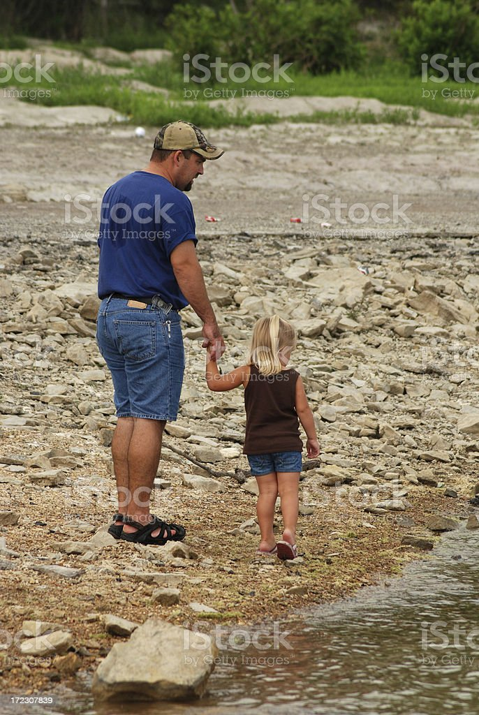 Walking on the Shoreline with Dad stock photo