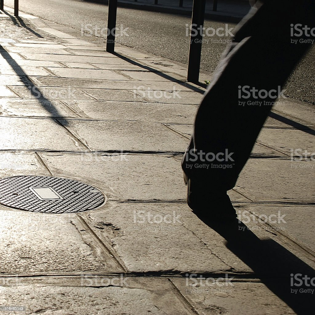 Walking on the sidewalk royalty-free stock photo