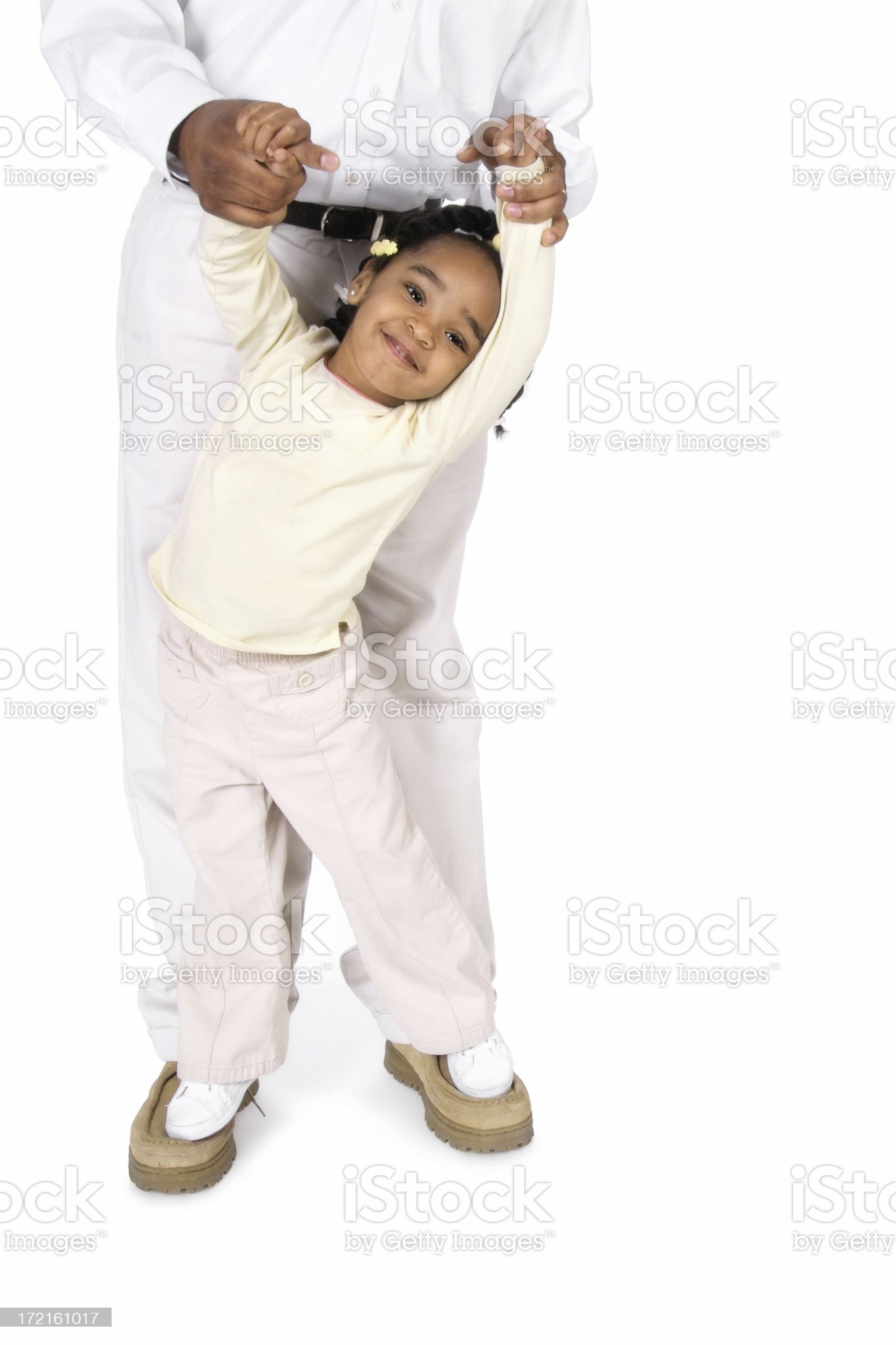Walking on Top of Daddy's Feet royalty-free stock photo