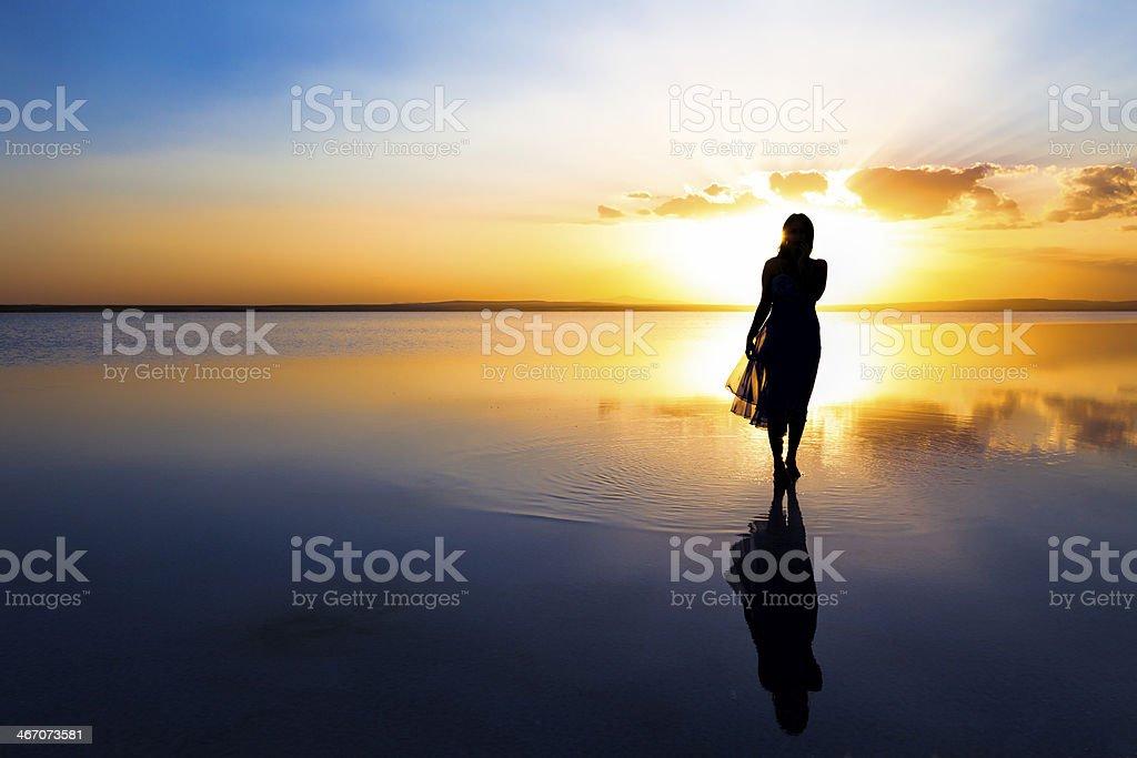 Walking on water at sunset stock photo