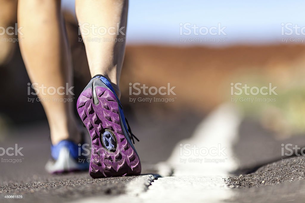 Walking or running legs in mountains, adventure and exercising stock photo