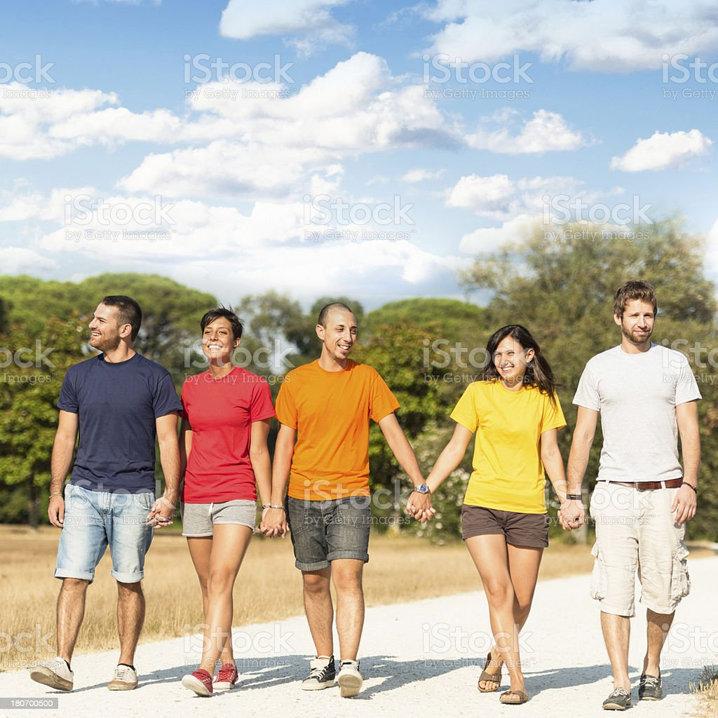 Walking outdoors with friends royalty-free stock photo