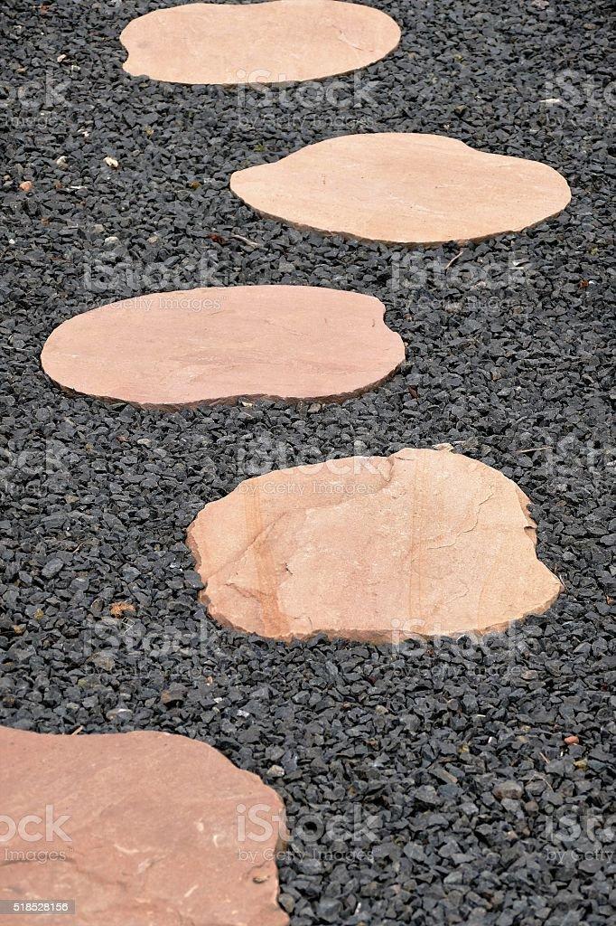 Walking path of stone plates stock photo