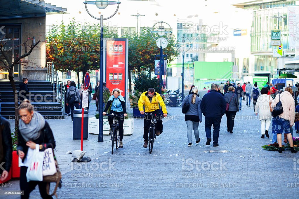 Walking people and cycling couple in Dortmund stock photo