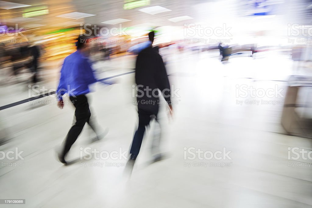 walking people in a shopping passage royalty-free stock photo