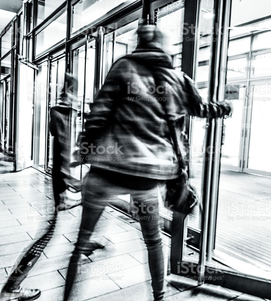 Walking people motion blurred stock photo