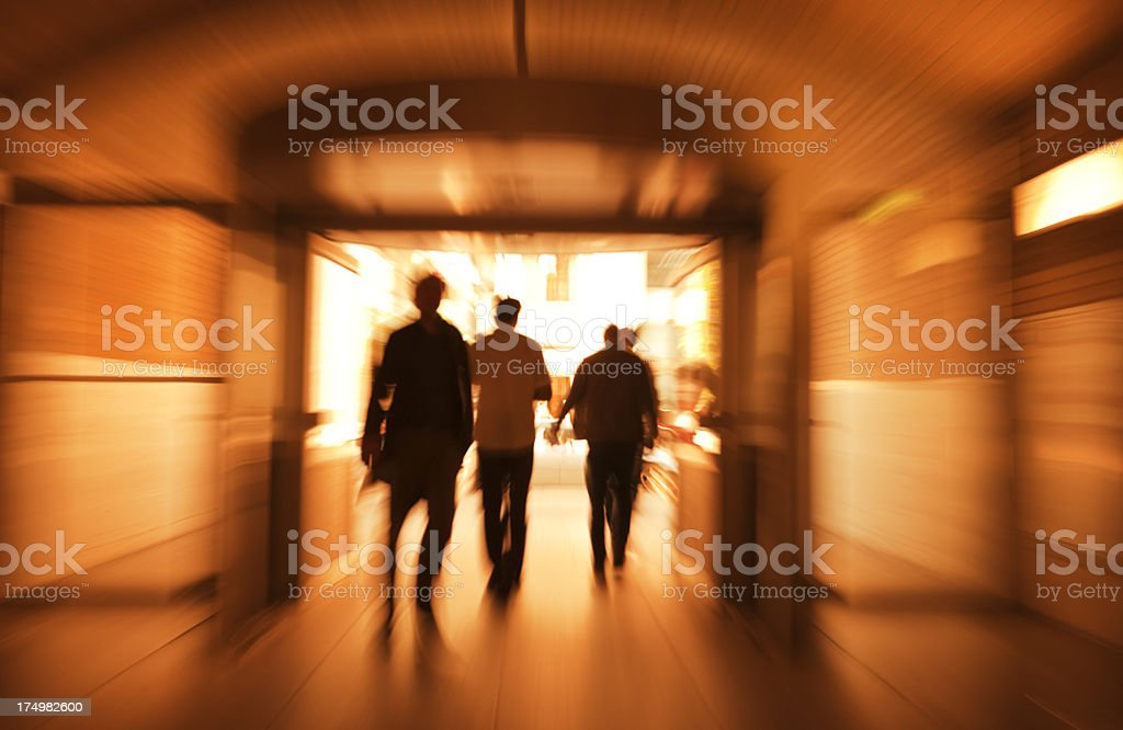 Walking People Silhouettes in Station Exit, Back Lit, Motion Blur royalty-free stock photo