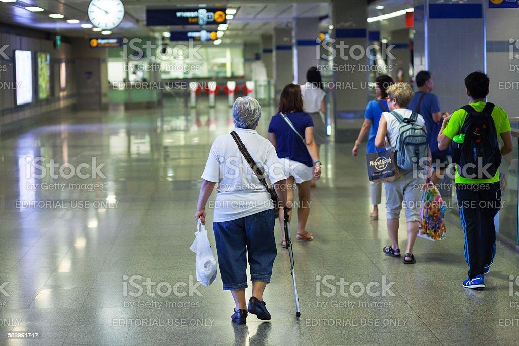 Walking senior woman with cane stock photo