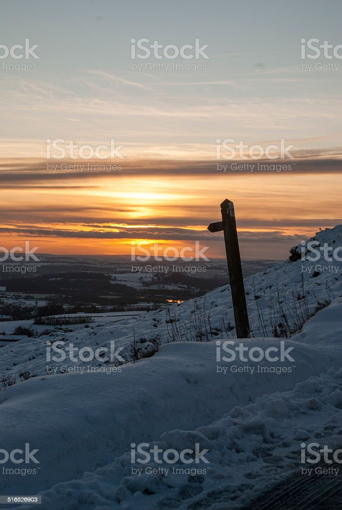 Walking sign and sunset stock photo