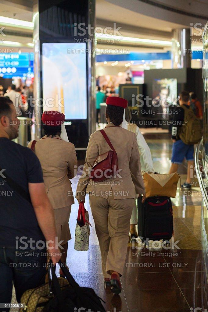 Walking stewardesses of Emirates stock photo
