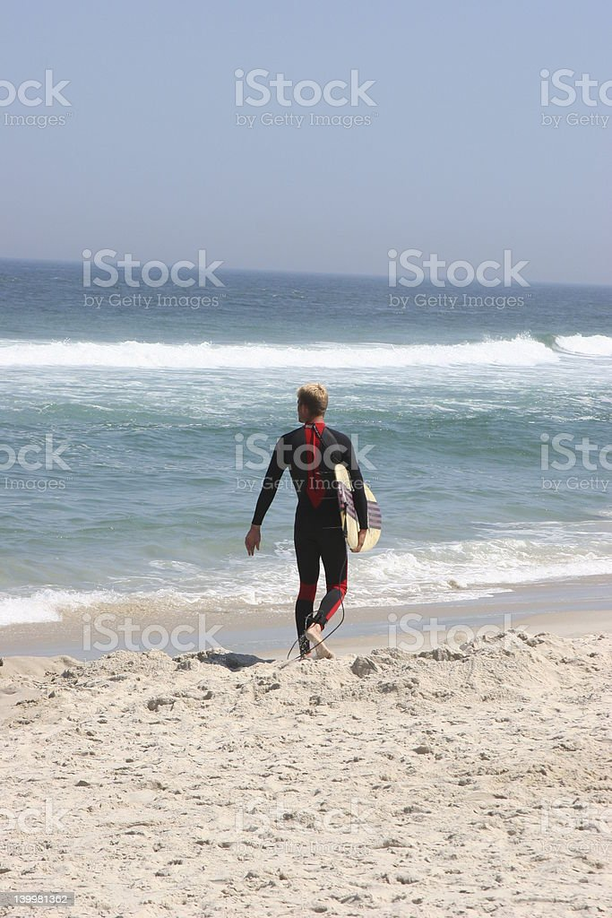 Walking surfer stock photo