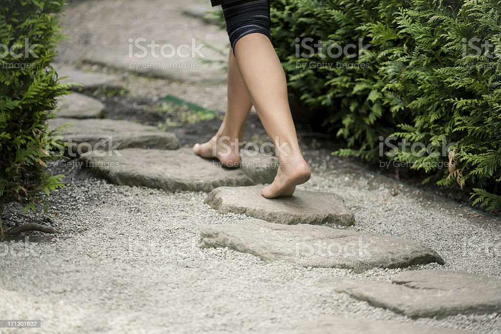 walking the stepping stones stock photo
