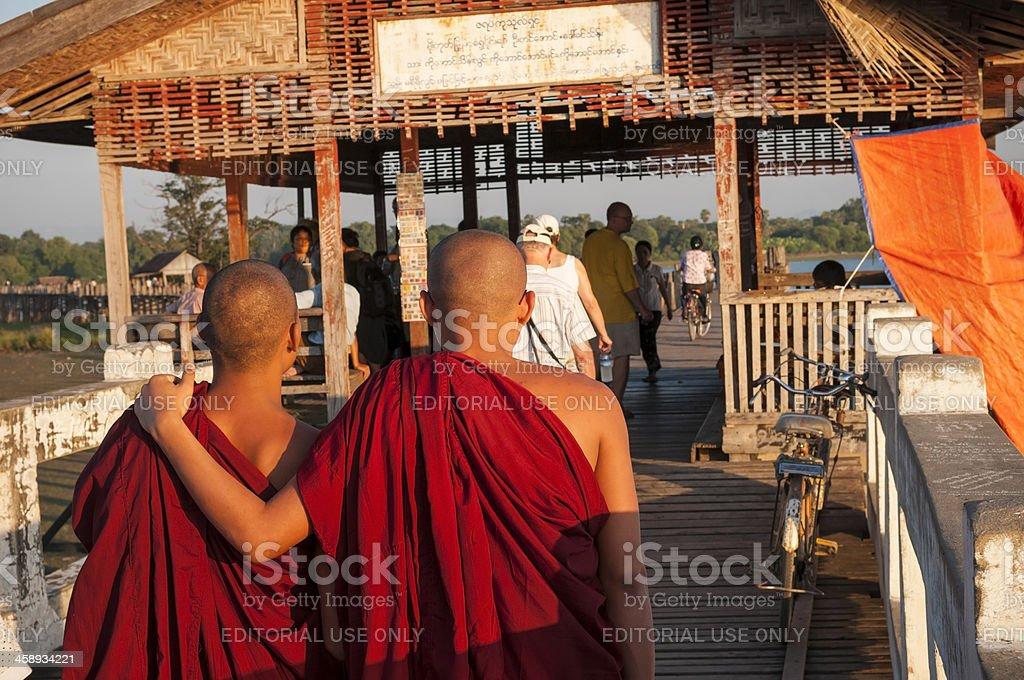 Walking the U Bein Bridge in Myanmar royalty-free stock photo