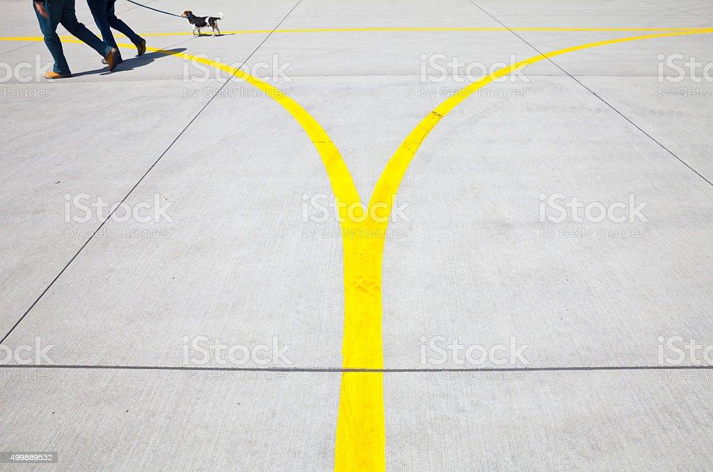 Walking the yellow line stock photo