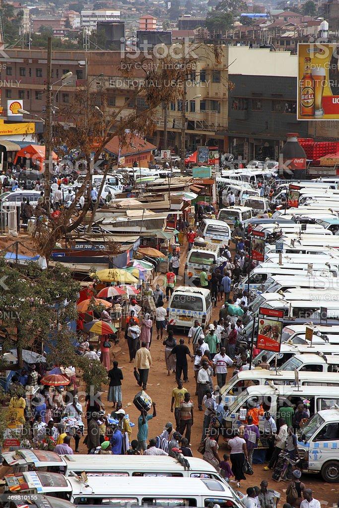 Walking through Kampala Taxi Park stock photo