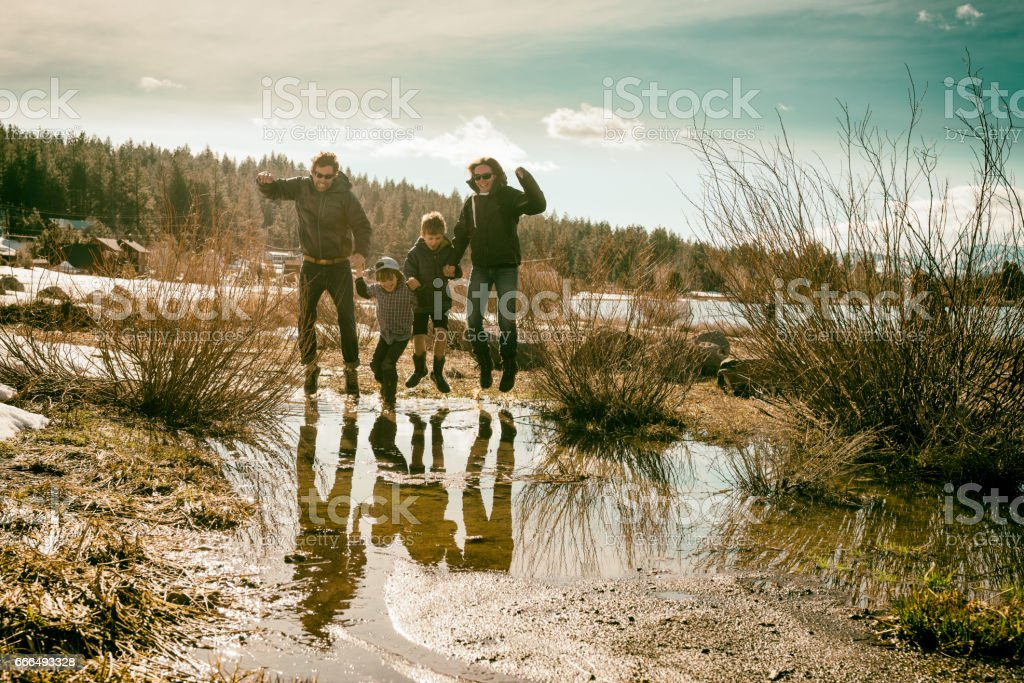 Walking through mud with family stock photo