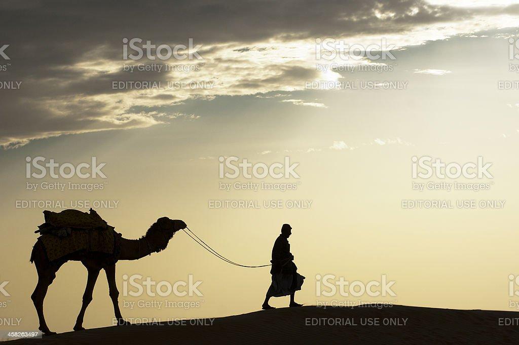 Walking through the sand dune stock photo