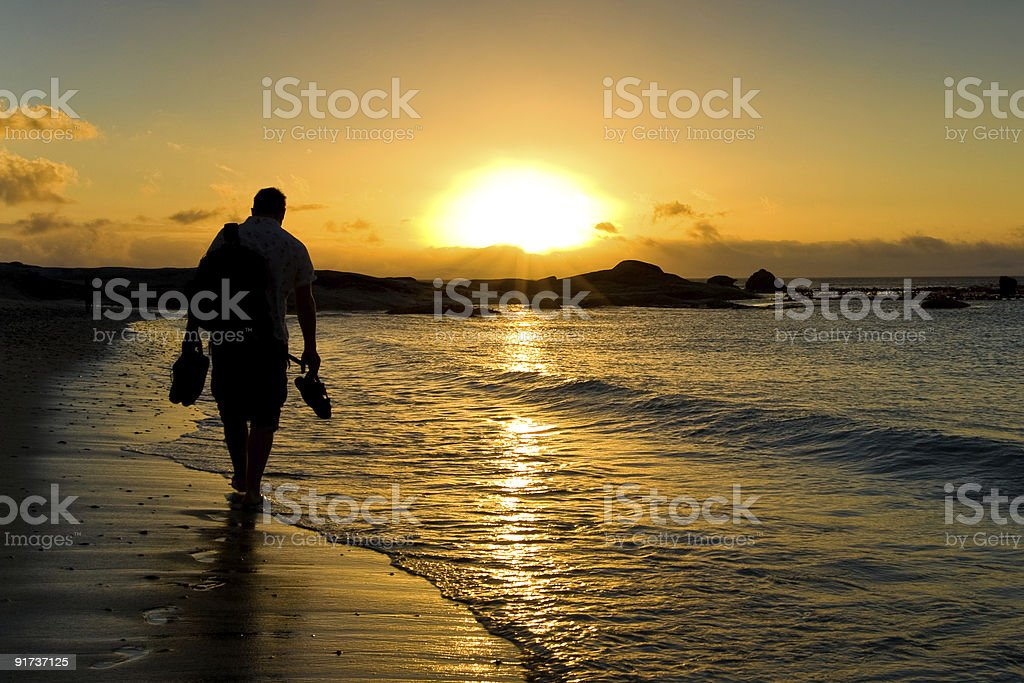 Walking to the sunset royalty-free stock photo
