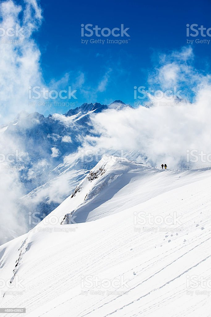 walking to the top of the world stock photo