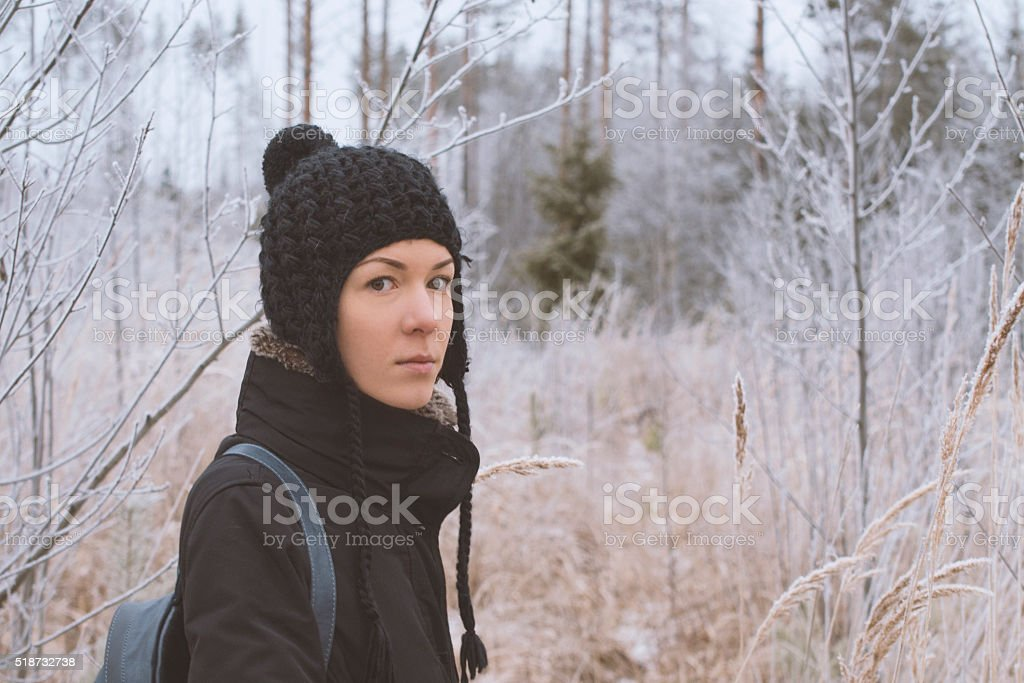 walking tour in the winter forest stock photo