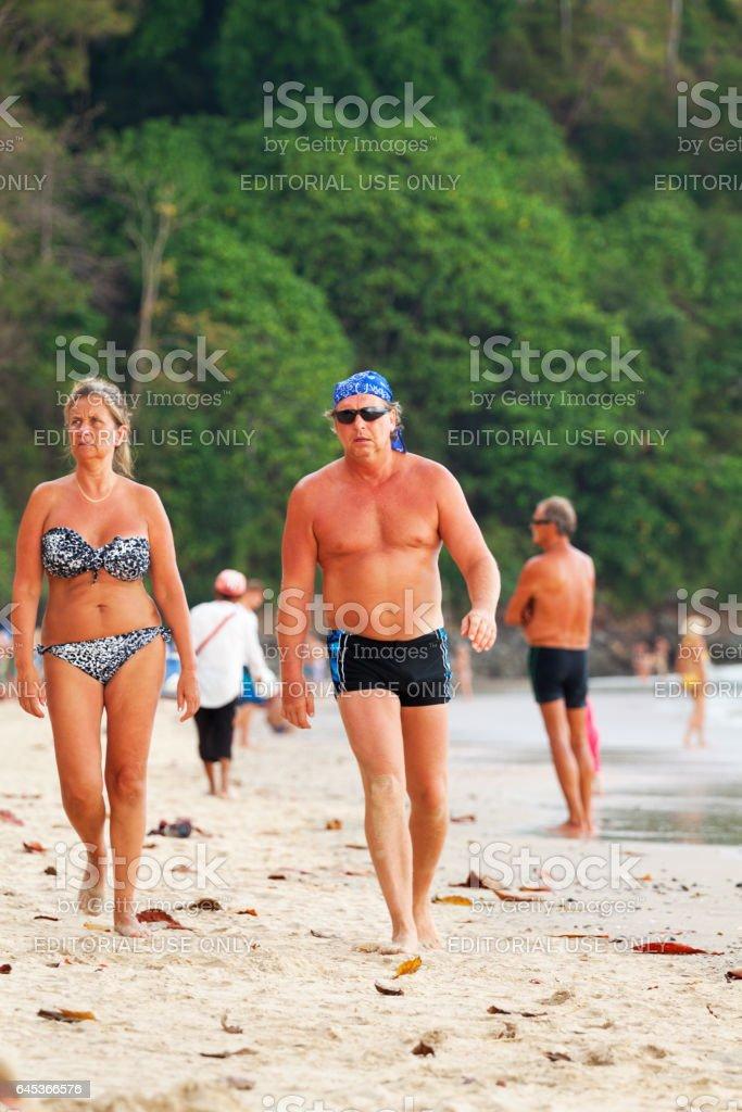 Walking tourist couple on beach of Ao Nang stock photo