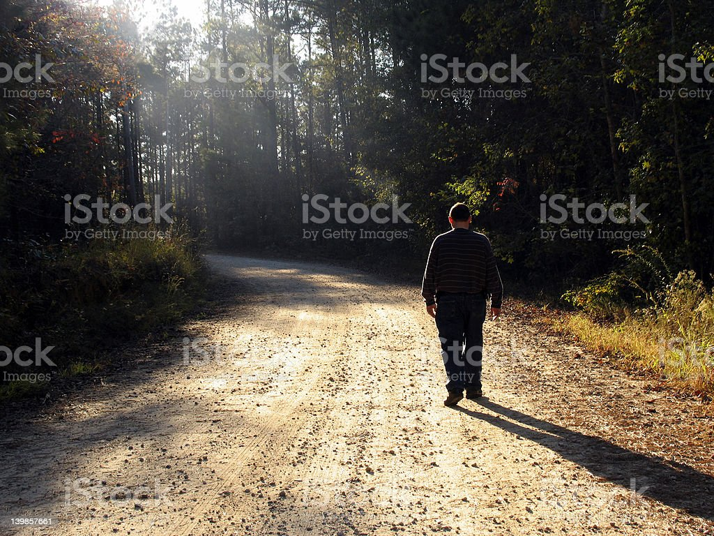 Walking up the road royalty-free stock photo