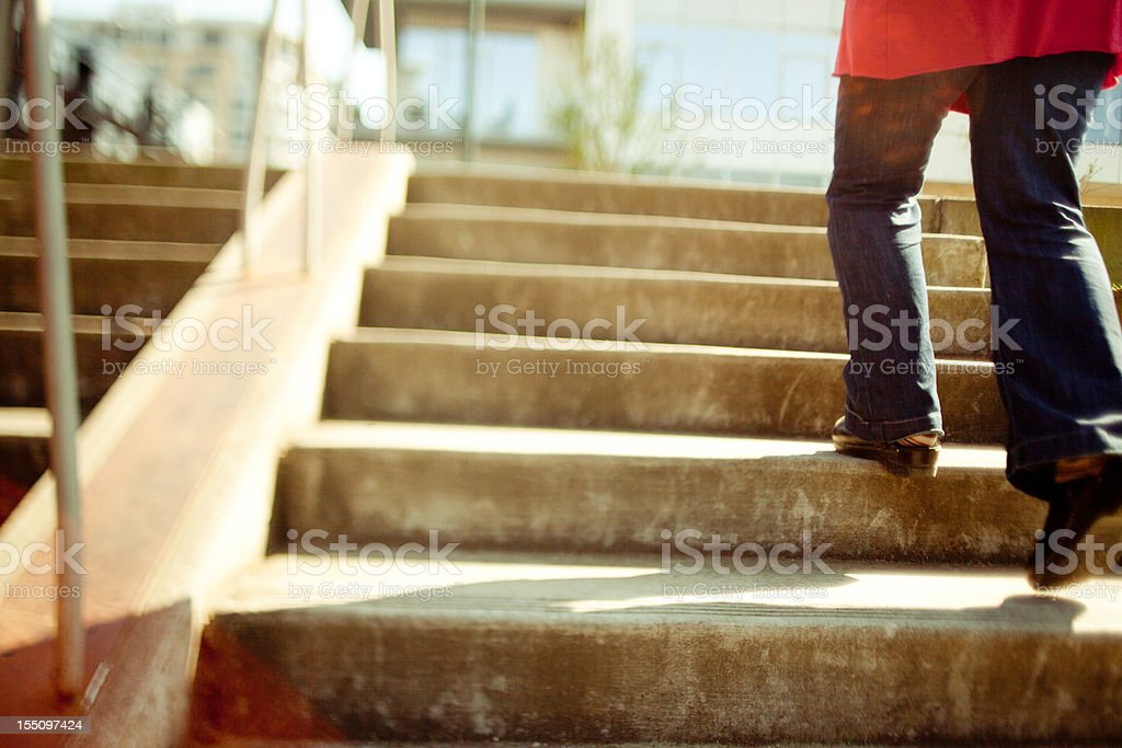 Walking up the stairs stock photo