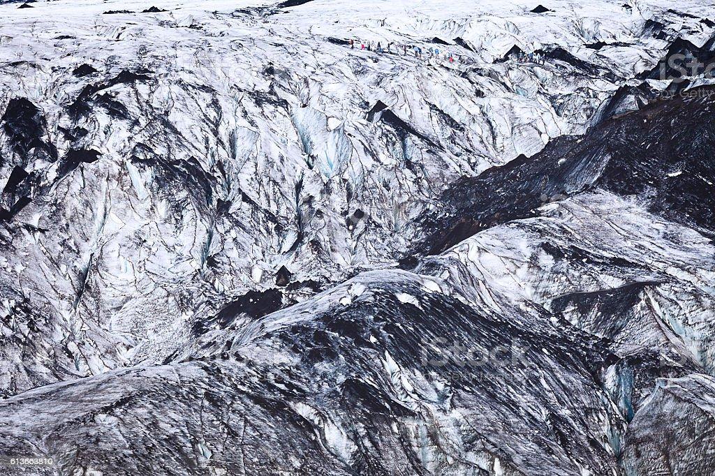 Walking up the Svinafellsjokull glacier stock photo