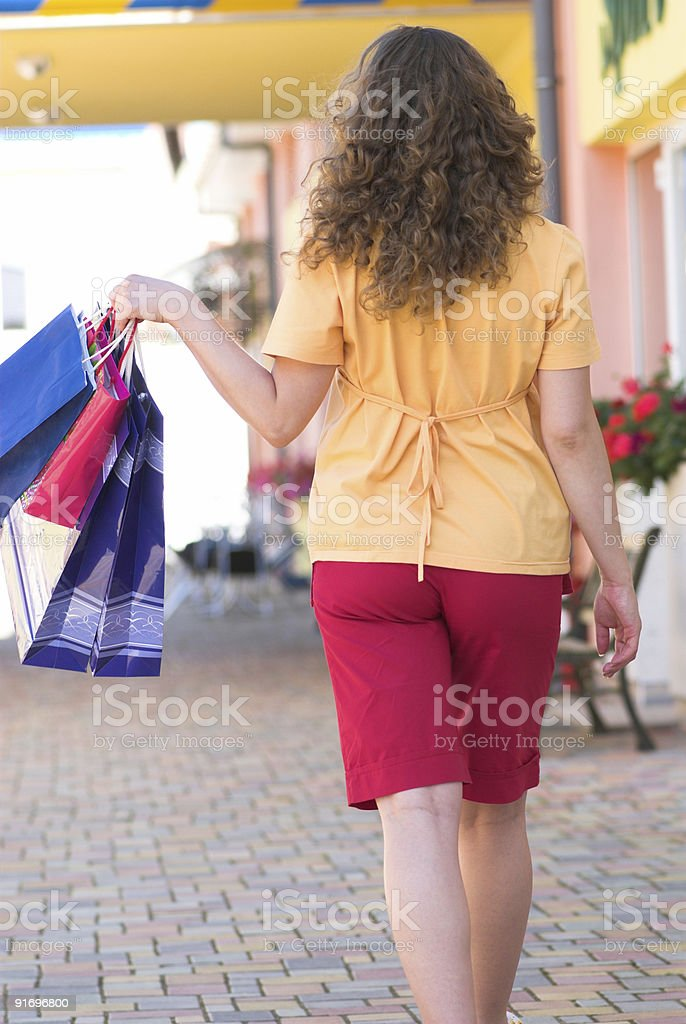 Walking with bags royalty-free stock photo