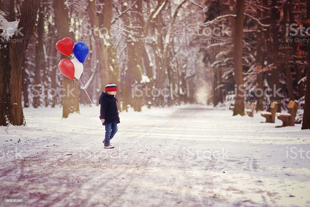 Walking with balloons royalty-free stock photo