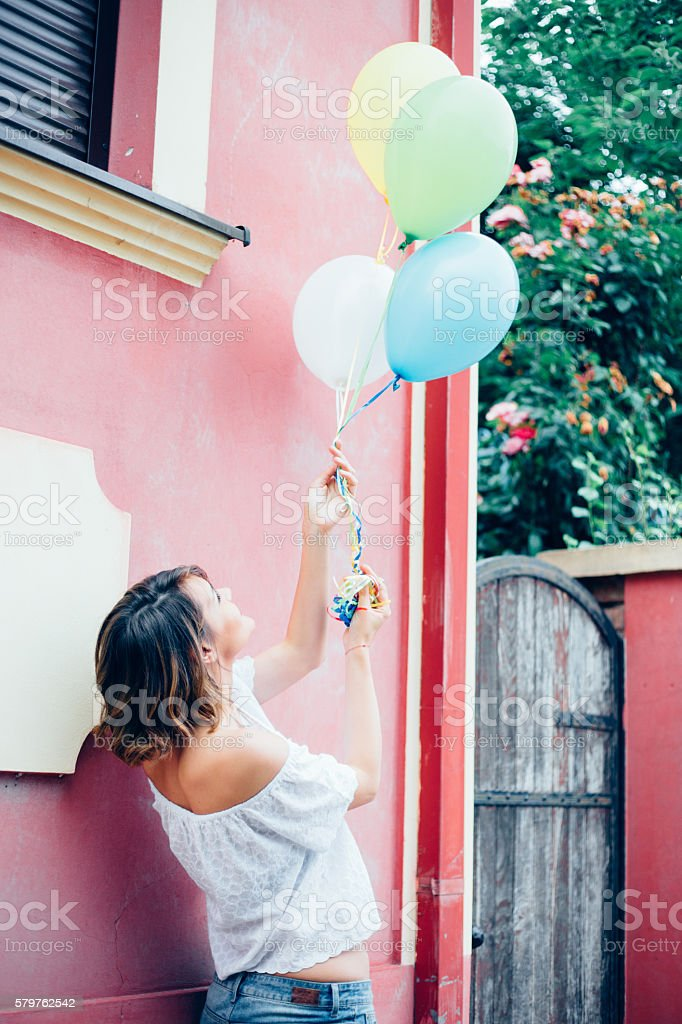 Walking with balloons stock photo