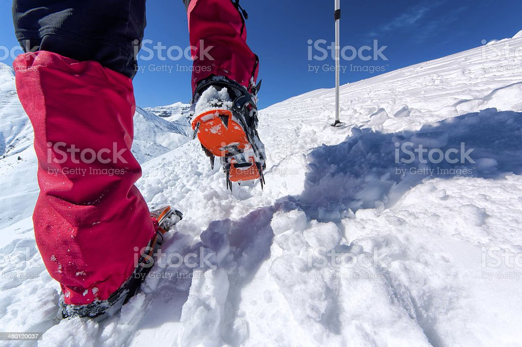 Walking with crampons stock photo