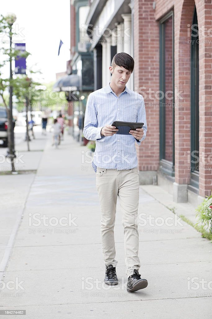 Walking with Digital Tablet royalty-free stock photo