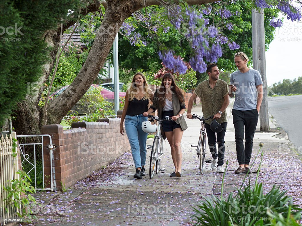 Walking with friends in the city suburbs stock photo