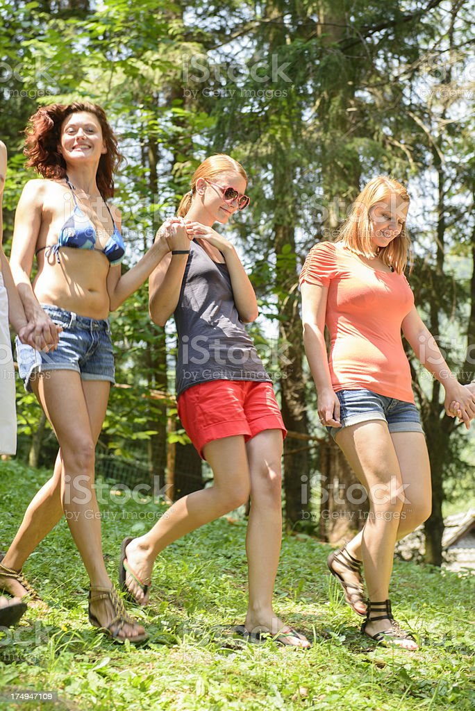 Walking with friends outdoors royalty-free stock photo