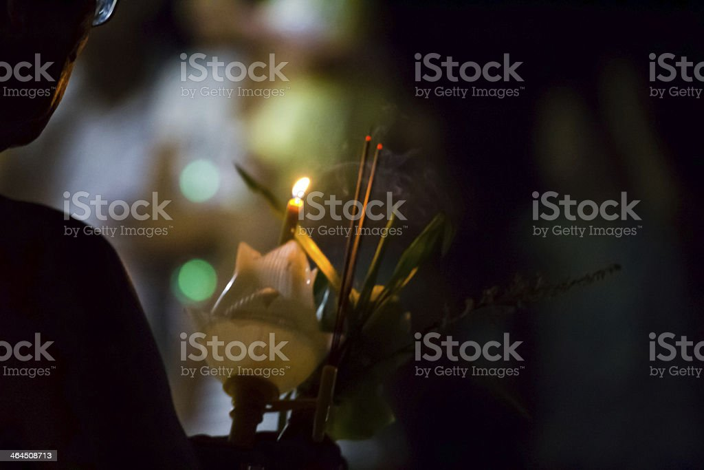 Walking with lighted candles in hand stock photo