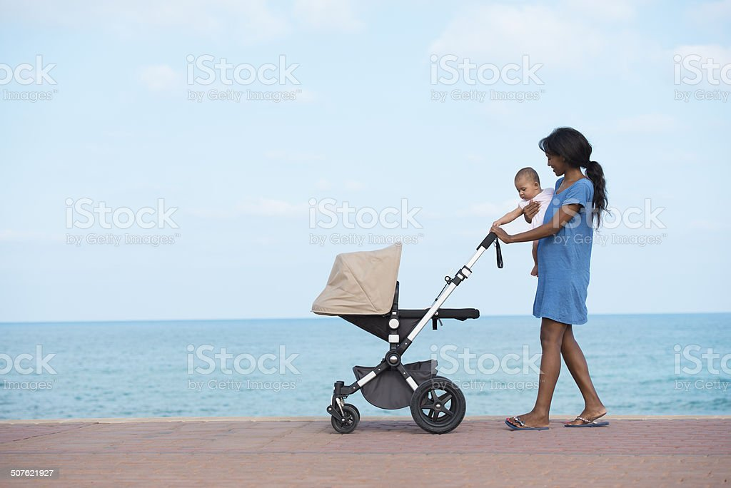 Walking with mother on seacoast. stock photo