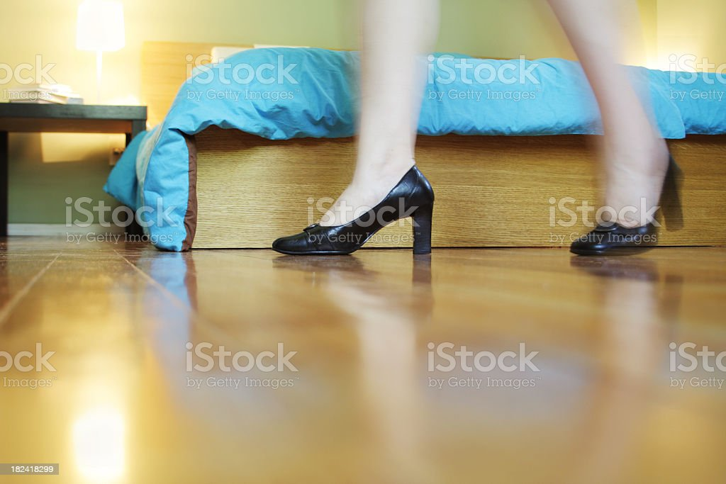 Walking with pumps in the bedroom royalty-free stock photo