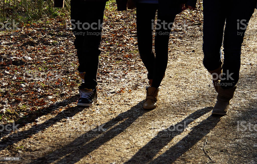Walking with shadow stock photo