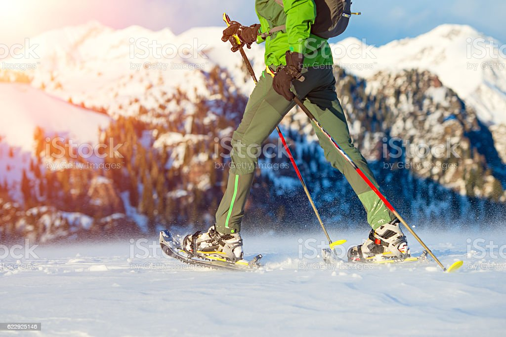 Walking with  snowshoes in mountains stock photo