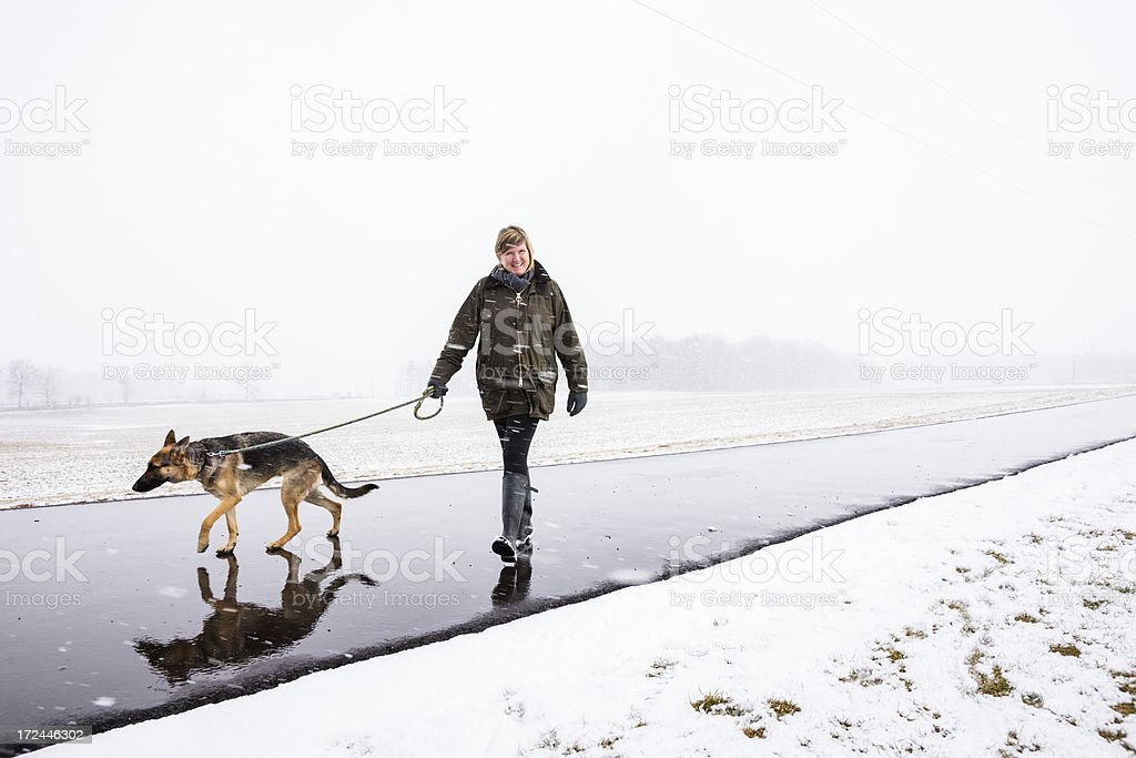 Walking with the dog in a snow storm royalty-free stock photo