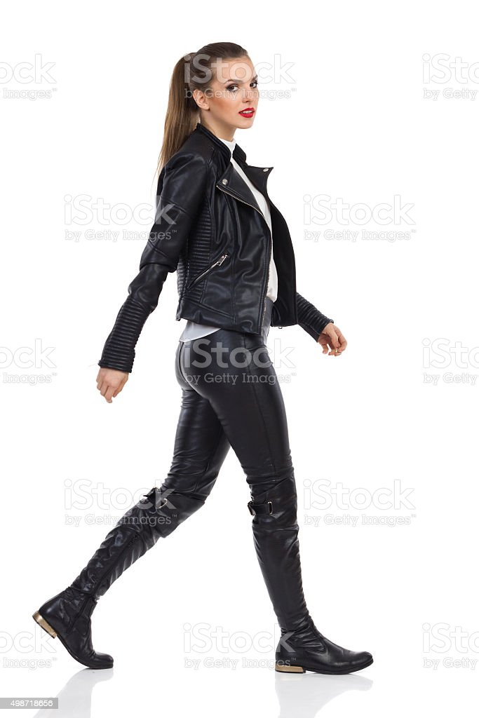 Walking Woman In Leather Clothes stock photo