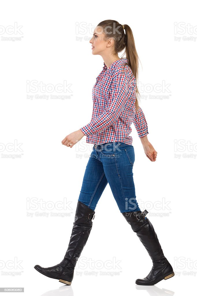 Walking Woman In Lumberjack Shirt stock photo