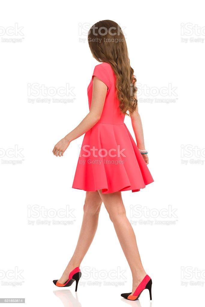 Walking Woman In Pink Mini Dress stock photo