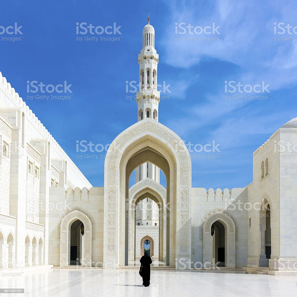 Walking Woman in Sultan Qaboos Grand Mosque Muscat Oman stock photo