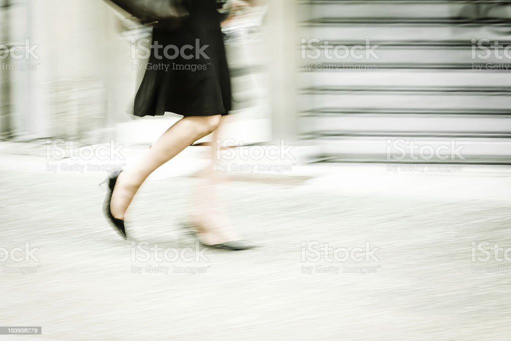 walking woman in the city stock photo