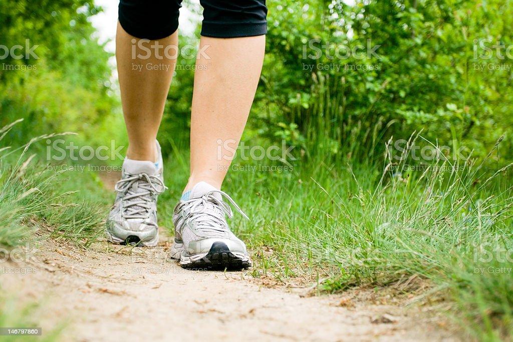 Walking woman stock photo
