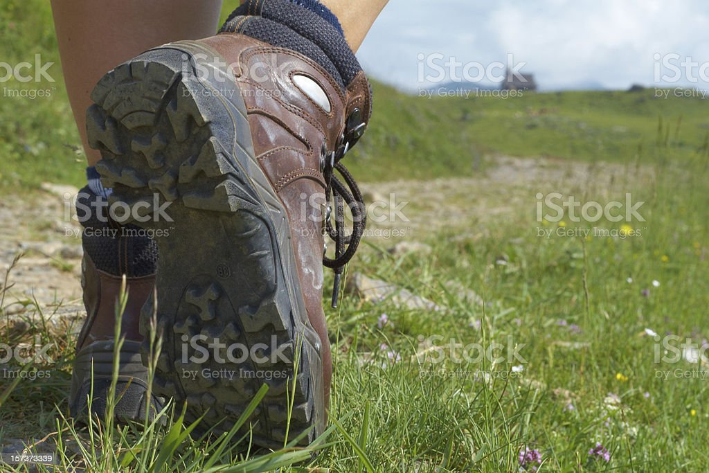 Walking woman shoes in mountains stock photo