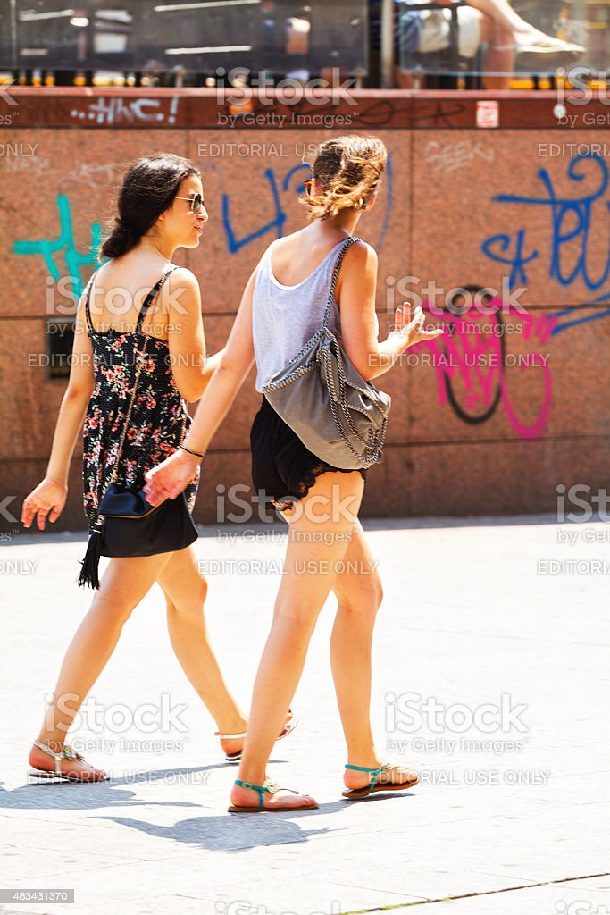 Walking young girls day in city at hot summer stock photo