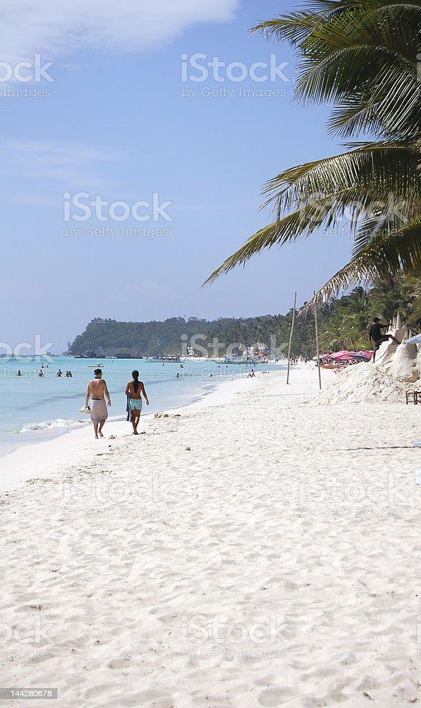 walkingon the beach royalty-free stock photo